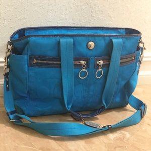 Bright blue Coach Diaper bag. Hot pink inside!